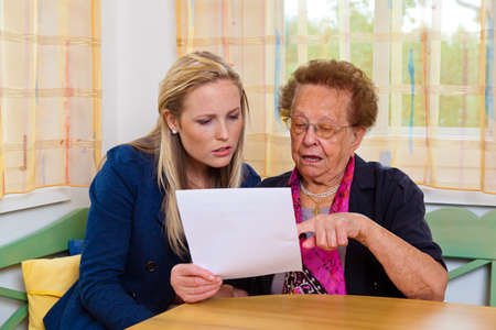 the inheritance: a grandson visited his grandmother and read a contract Stock Photo