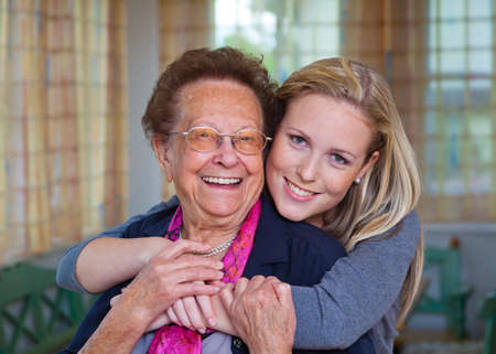 a grandson to visit his grandmother. fun and pleasure in the embrace. photo