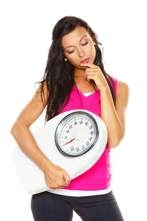 lose: a young woman is unhappy with your body weight. try to be easier on the scale.