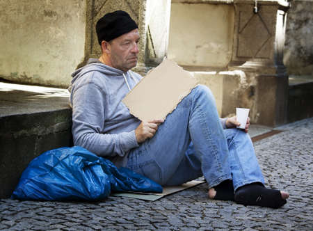owe: an unemployed homeless beggar is hungry and has