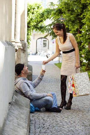 hartz 4: a rich young woman gives a beggar money