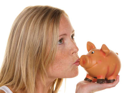 a young woman saves money and coins for the future. preparedness and save. photo