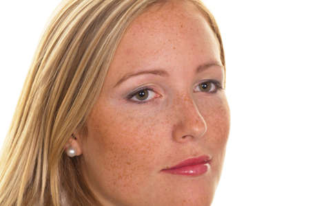portrait of a young blond woman with freckles on a white background photo