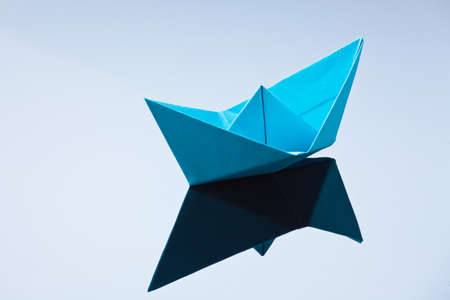 longing: a ship made of paper folded. photo icon to tinker and longing.