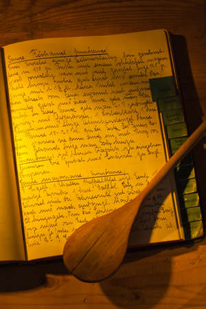 historically: an old handwritten cookbook with recipes. old recipes. Stock Photo