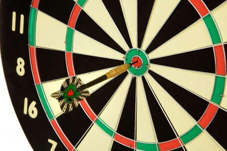 an arrow game with a dart has hit the mark. Stock Photo - 11153924