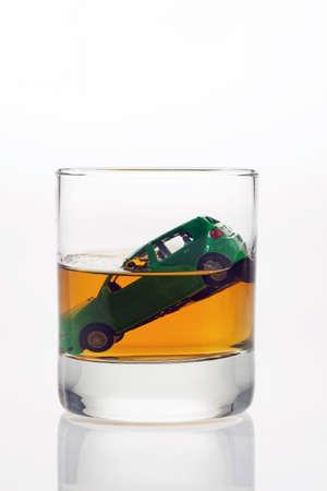 thousandth: car keys and a jar of alcohol on a table