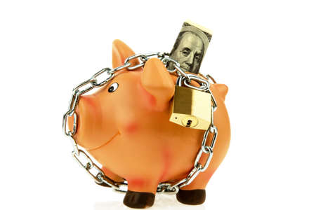 precaution: a piggy bank with money and dollar chain. safety in and save the system money.