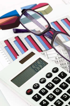 controlling: a calculator and various statistics when calculating the balance sheet, revenue and profit. Stock Photo