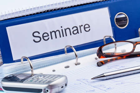 an icon image for further education, training and adult education. folder and documents in a seminar photo