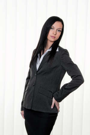 work worker workforce world: a young, confident business woman in business attire