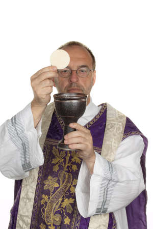 liturgy: a catholic priest during communion in worship