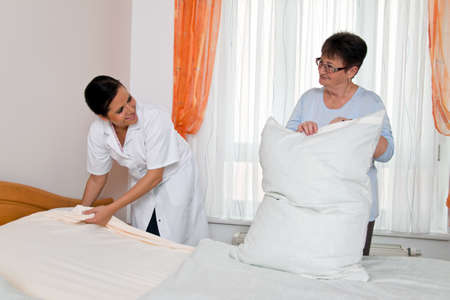 old age care: a nurse in elderly care for the elderly in nursing homes