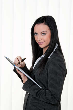 salaried: manager with a clipboard taking notes in controlling Stock Photo