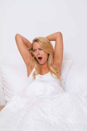 dormitory: young pretty woman and waking up at. good mood in the morning in bed Stock Photo