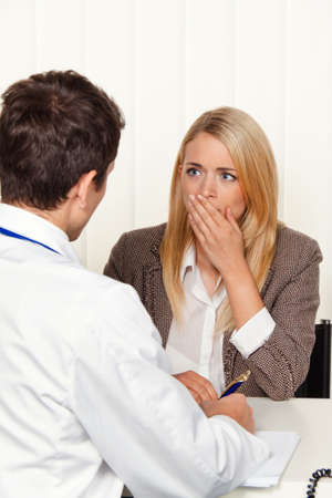 findings: medical consultation. patient and doctor talking to a doctors office