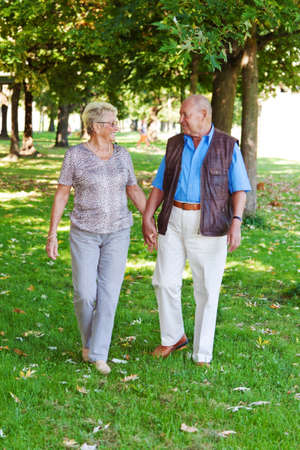 mature senior couple in love. couple goes for a walk
