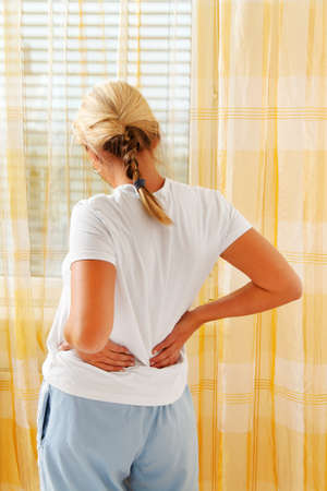 arthritis back: a woman on the morning after waking up the pain.