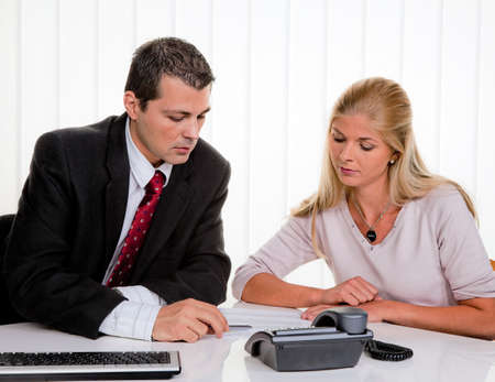 bankruptcy: husband and wife in a counseling session Stock Photo