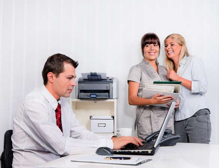 bullying in the workplace an office. women are talking about colleagues Stock Photo