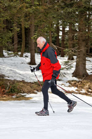 senior winter snow on the nordic walking photo