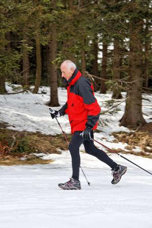 senior winter snow on the nordic walking photo