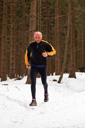 senior-country skiers in winter on snow when jogging photo