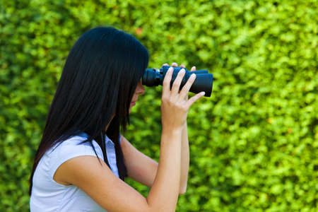 young woman with binoculars looking to the future Stock Photo - 11276092