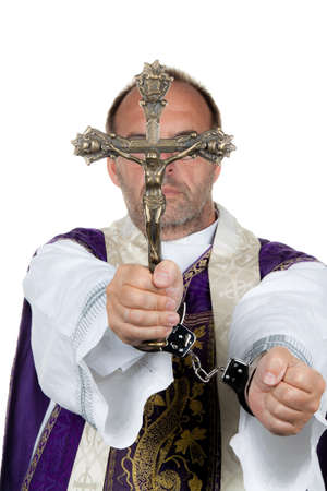 accusation: icon image abuse in the church. priest with handcuffs