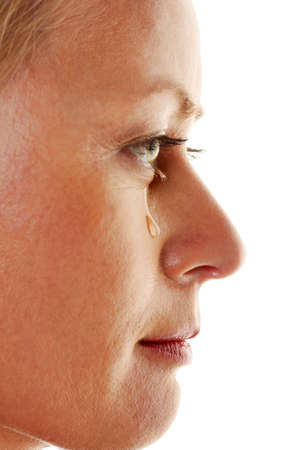 psychologically: a sad woman with tears on her face