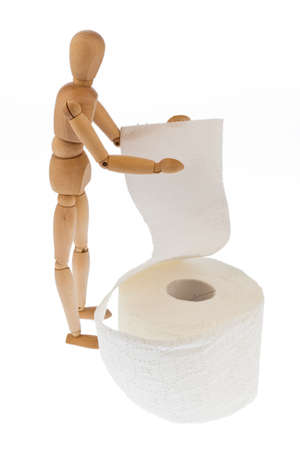 a wooden figure and a roll of toilet paper. Stock Photo - 11275967