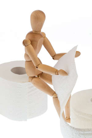 a wooden figure and a roll of toilet paper. Stock Photo - 11275969