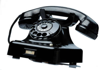 an old, old landline telephone. phone on a white background. photo