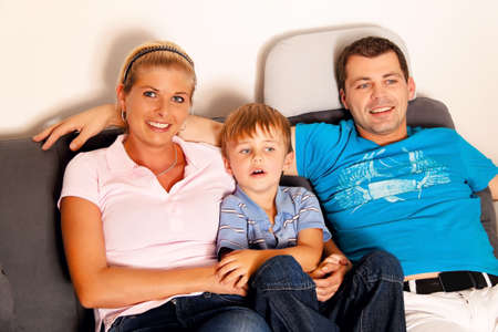 peoplesoft: a family is sitting in the living room and watching tv