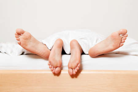 in chief a couple feet in bed. love, sex and partners. Stock Photo - 11275871