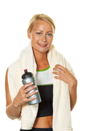 an athletic young woman after a workout at the gym.