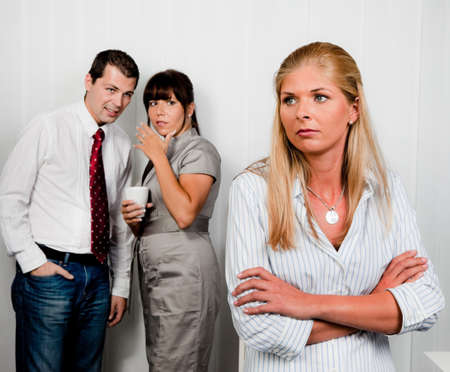 woman work: bullying in the workplace an office. gossip in the office Stock Photo