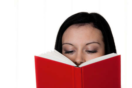 well read: woman with book reading against a white background Stock Photo