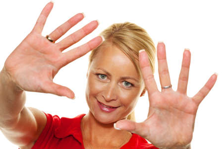 woman stop: a young woman holds her hands to her face. Stock Photo