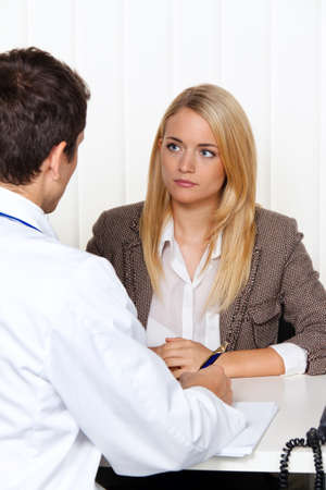 supplementary: medical consultation. patient and doctor talking to a doctors office