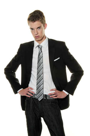 insipid: a skeptical young man in the studio. dressed in a suit Stock Photo