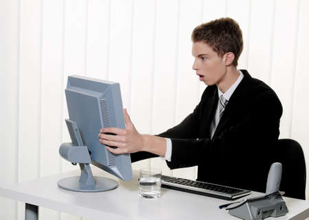 a man has problems with computer viruses and spam in the office photo