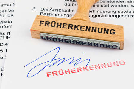 a stamp made of wood lying on a document. early inscription Stock Photo - 11622579