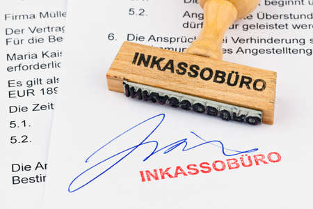 insolvency: a stamp made of wood lying on a document. label collection agency