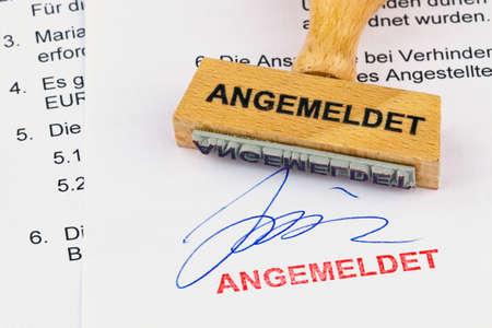 klinik: a stamp made of wood lying on a document. remember inscription Stock Photo