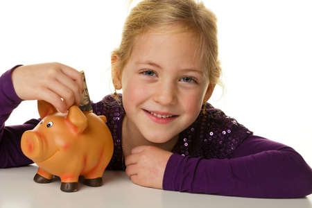 assessment system: a small child puts a dollar bill into a piggy bank. dollars.