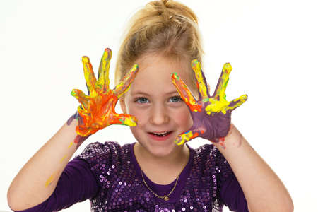 vivre: a child painting with finger paints. funny and creative. Stock Photo