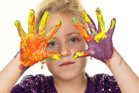 gamut: a child painting with finger paints. funny and creative. Stock Photo