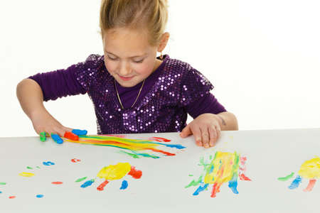 color therapy: a child painting with finger paints. funny and creative. Stock Photo