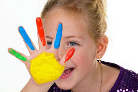 a child painting with finger paints. funny and creative.